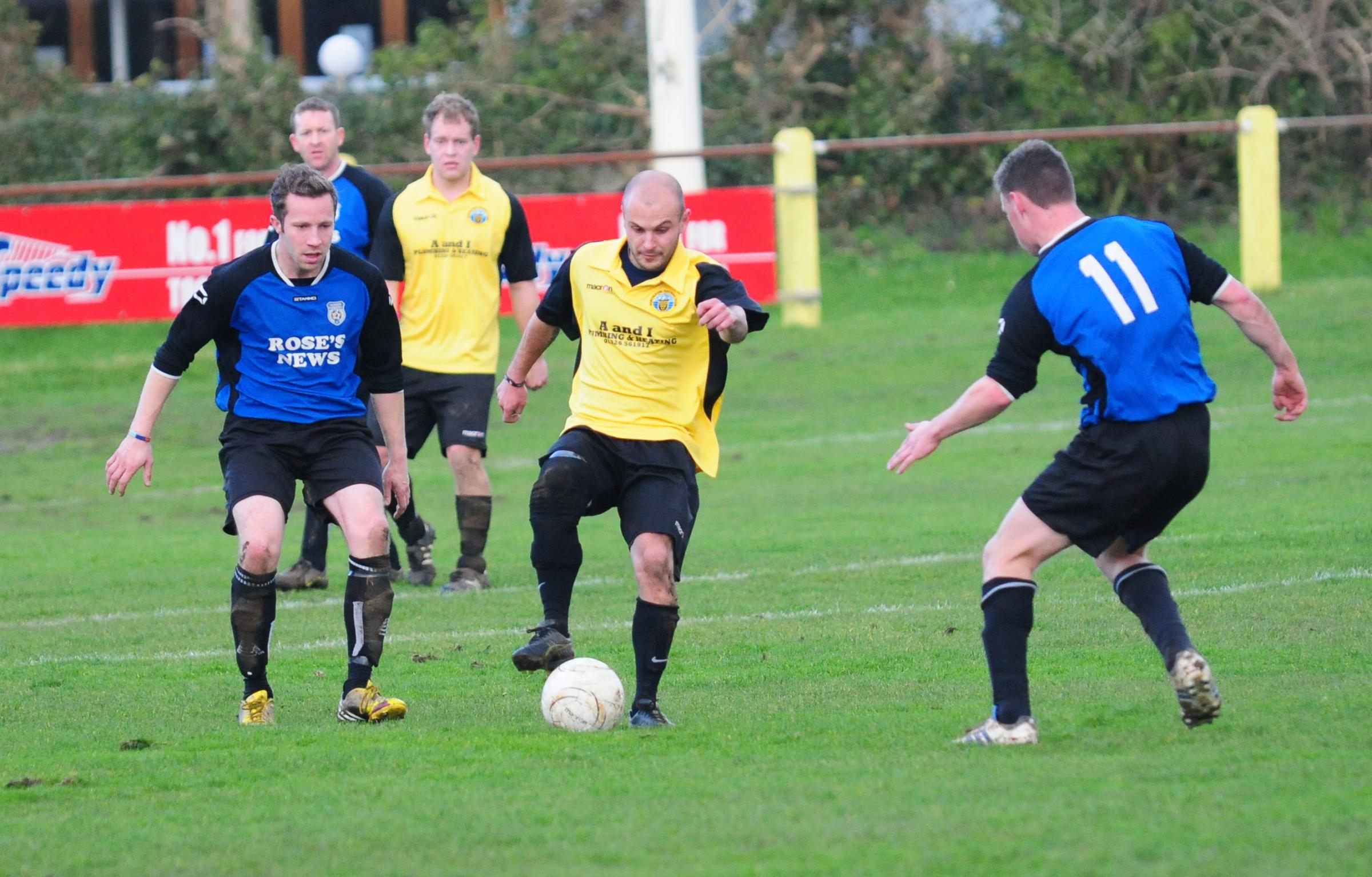 Porthleven's Marcus Smith under pressure during his side's 0-0 draw with Falmouth Athletic at Gala Parc