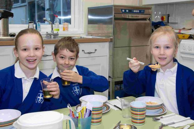 Pupils and staff toast the success of new school breakfast club: PICTURES