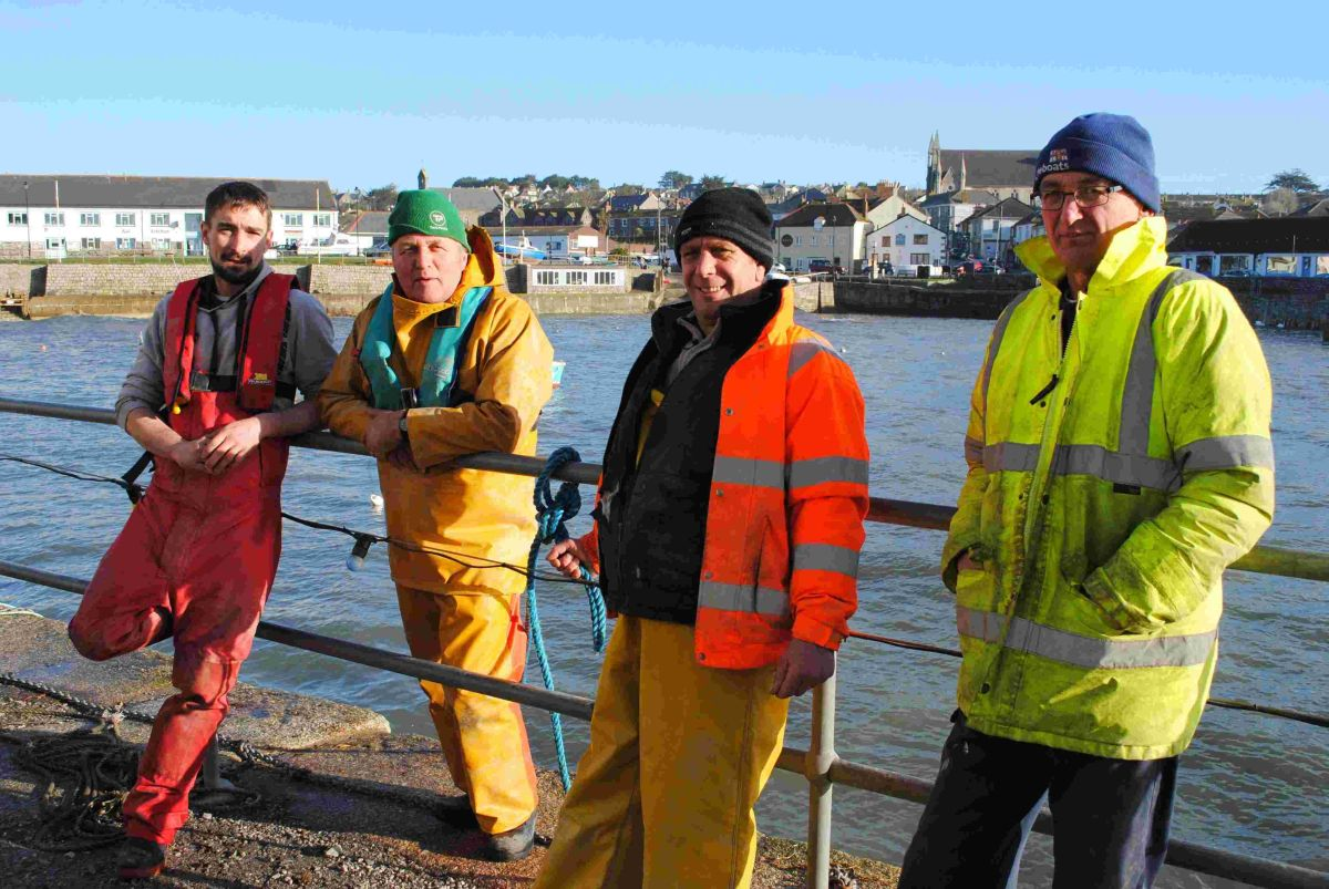 Porthleven fishermen Wayne Ward, Mike Perkins, Nigel Pepperell and Jonathan Fletcher were among those helping to pull all the boats from the harbour