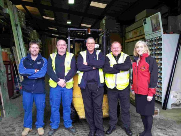 Porthleven firm helps bail out Helston Air Ambulance shop after it springs a leak