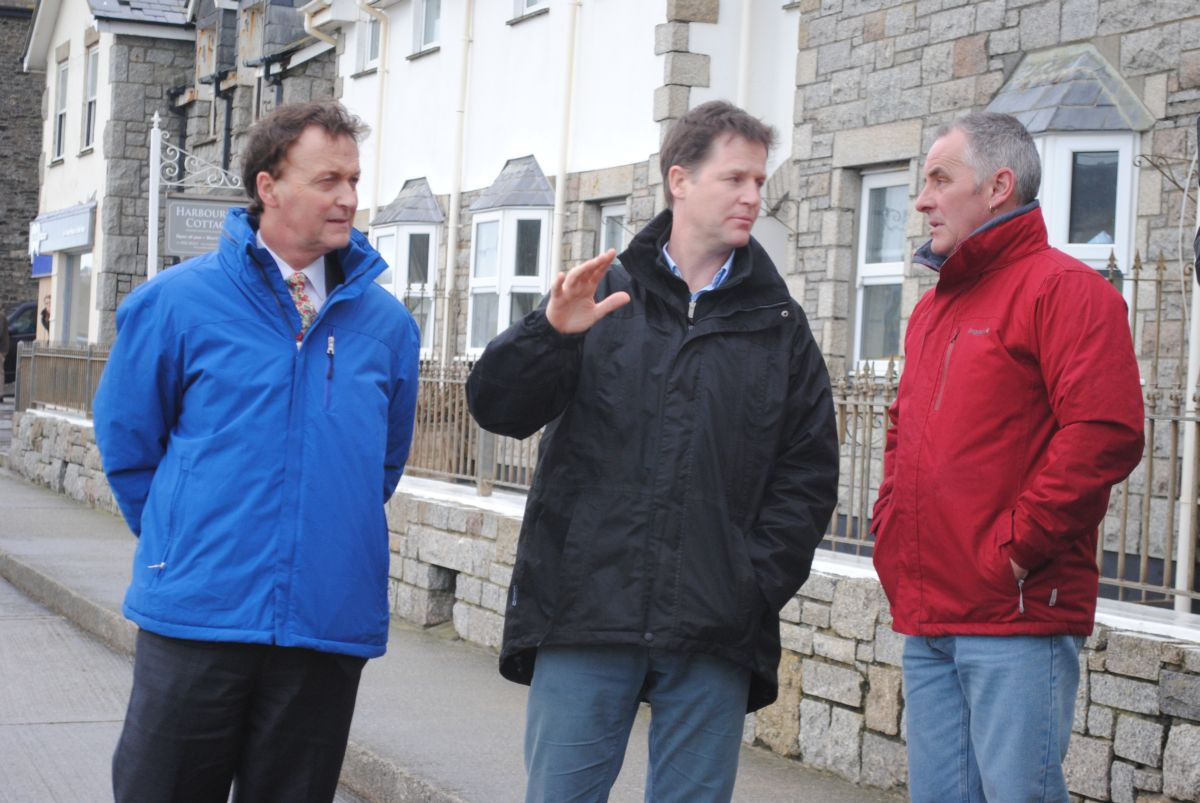 Deputy prime minister Nick Clegg (centre) meets with Porthleven harbour master Phil Ward (right) this afternoon, accompanied by West Cornwall MP Andrew George
