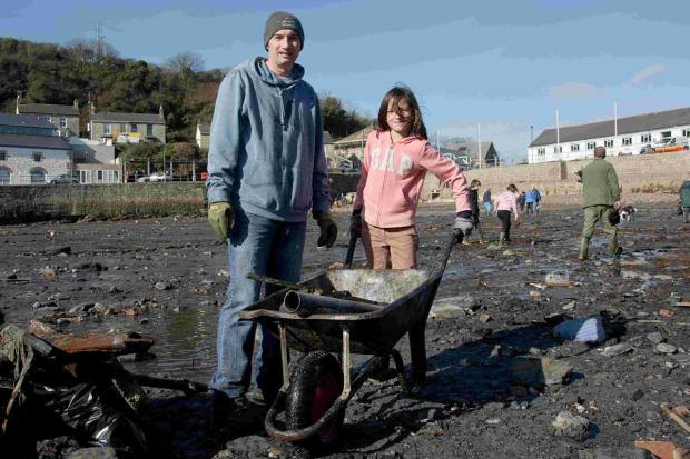 Falmouth Packet: Porthleven rallies round to clean up harbour: PICTURES