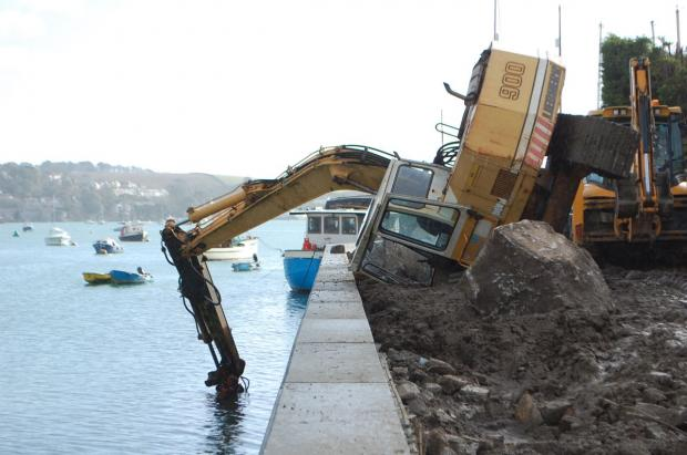 Lucky escape as digger topples over on Penryn quay: PICTURES
