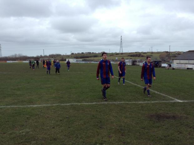 Wendron players leave the field after Saturday's Senior Cup match