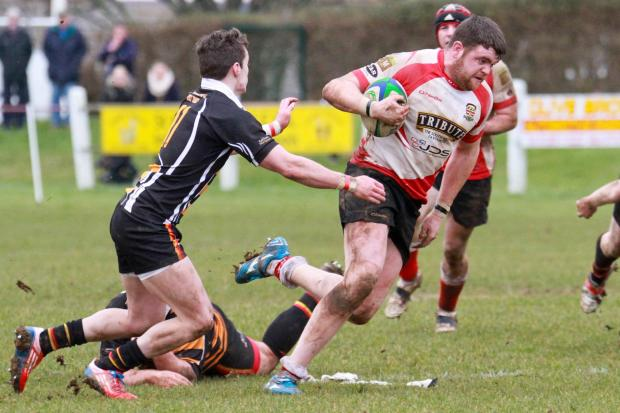 Ben Kemp charges past St Austell winger Ashley Taylor. Picture: John Beach