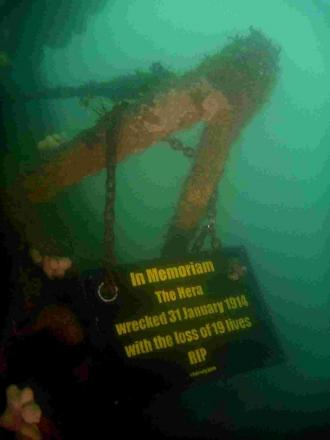 Divers place plaque on sunken ship to mark 100 years since tragedy