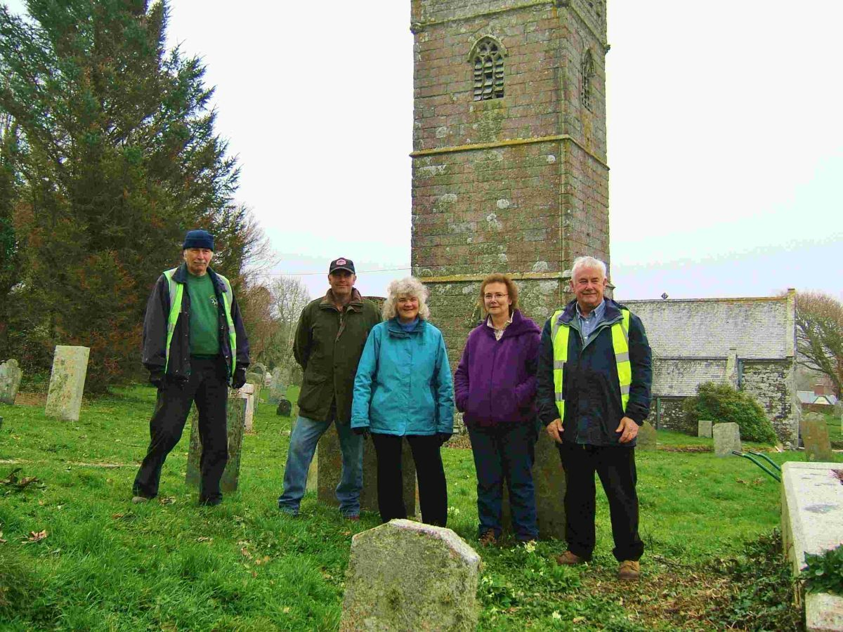 Community payback team clear 10 years of growth from churchyard