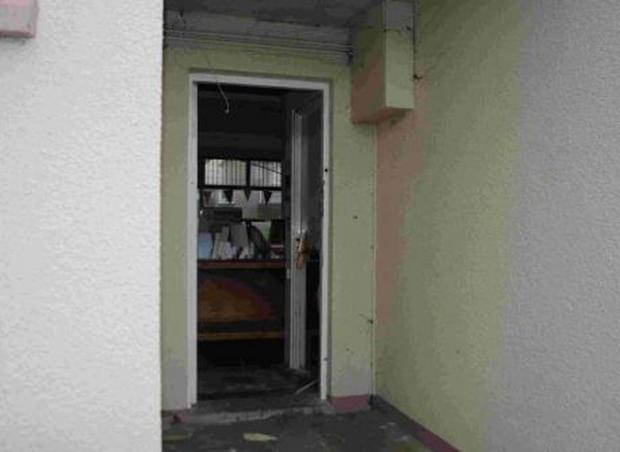 The damaged door at the scene