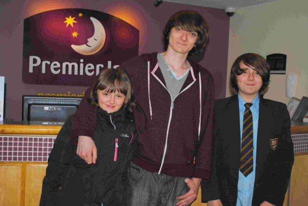 Helston Community College student Thomas, centre with sister Emily and brother Jacob