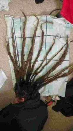 Hair today, gone tomorrow! Lizard RNLI supporter chops off 32 inch dreadlocks for funds