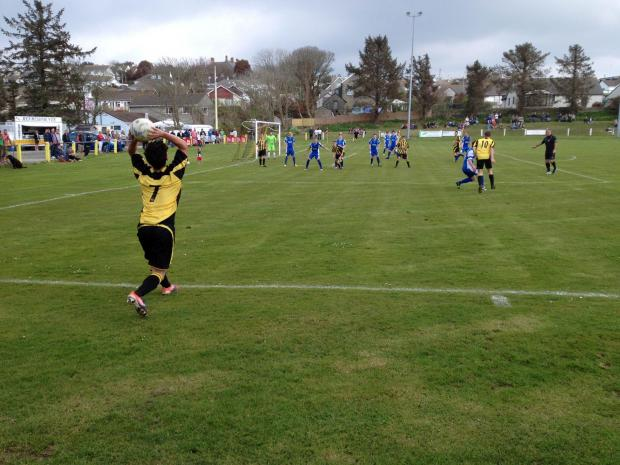 Falmouth Packet: Porthleven's Kyle Fraser gears up for a long throw into the Helston box at Gala Parc on Good Friday