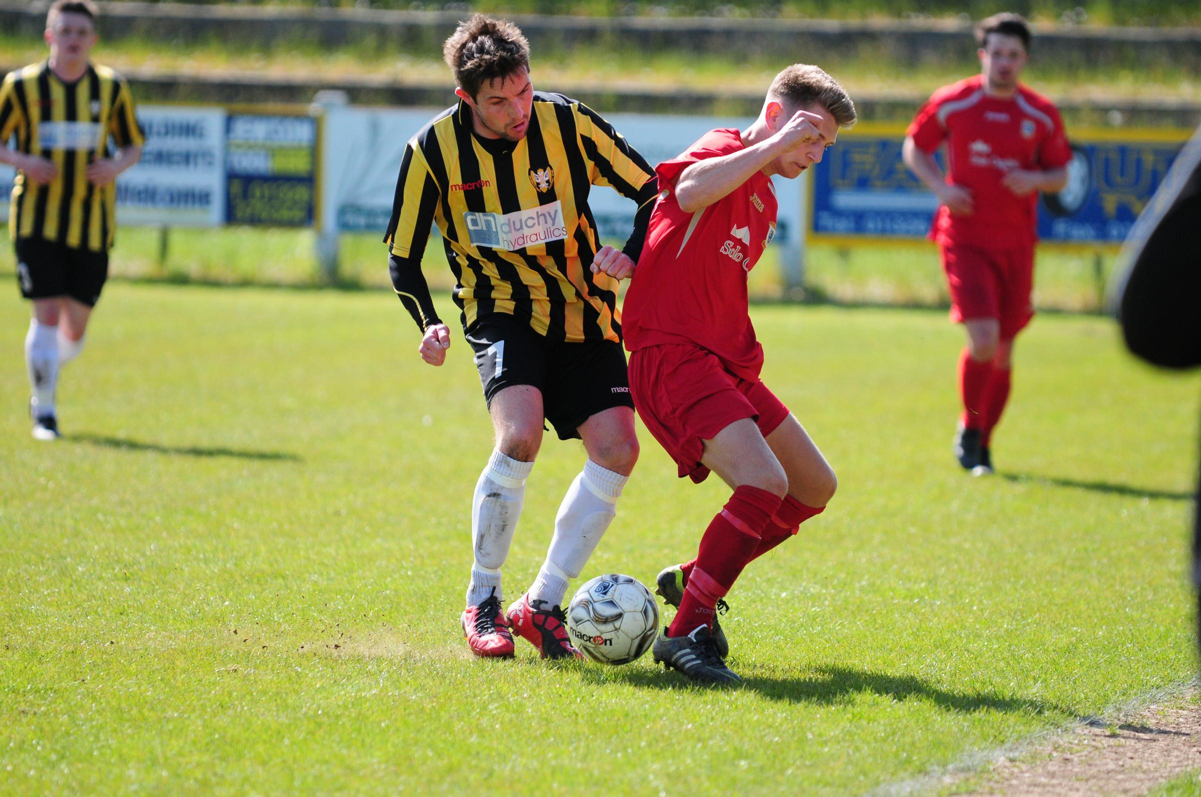 Dan Richardson challenges for the ball at Bickland on Saturday