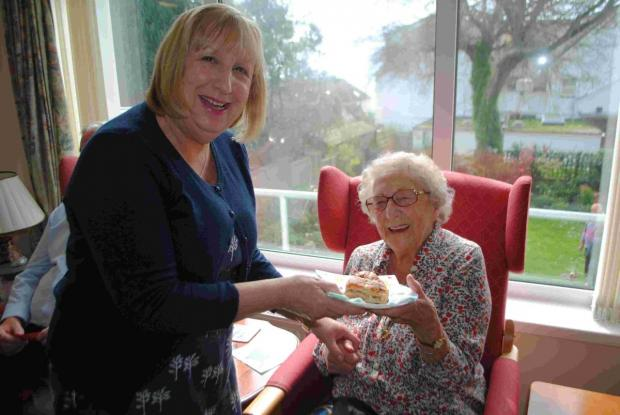 Falmouth care home residents enjoy hot cross buns for funds