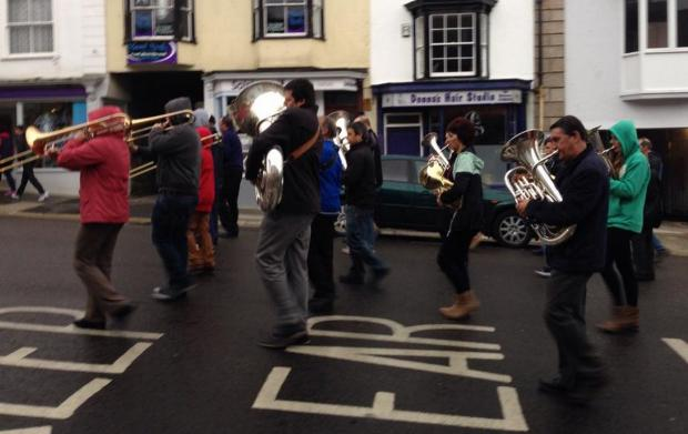 Helston Town Band braved the drizzle for their early May Day walk. Photo: Sam Autie