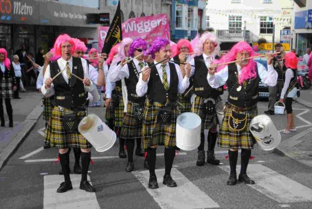 Falmouth Marine Band marks 25 years of fundraising... and crazy costumes