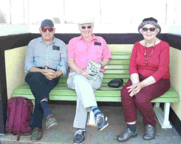 Falmouth Packet: Visitors relax on the newly painted bench just hours before it was stolen on Saturday