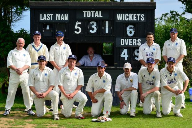 Falmouth Packet: Gorran posing in front of the scorebox with their mammoth total on it. Picture: DAVID J BLANKS/CARTEL