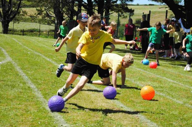 Falmouth Packet: World cup inspires Halwin Primary's sunny sports day: PICTURES