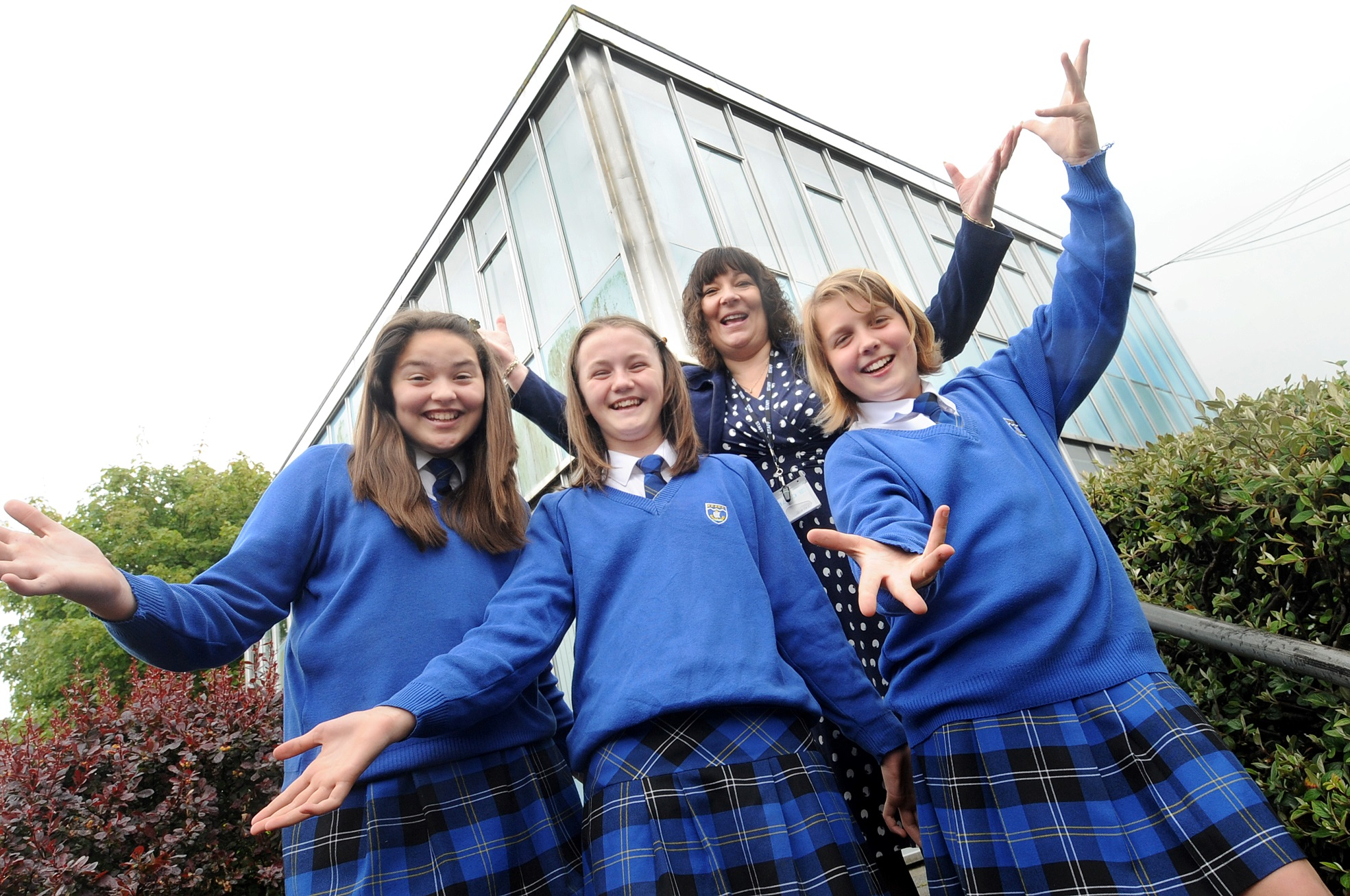Students Lowenna Pollard, Harriet Eamer, Kacey Wignall celebrating the new funding with Jackie Parker, director of fi