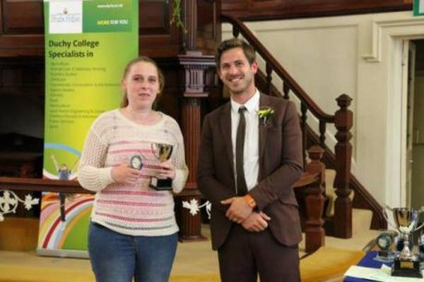 Animal Management student Claire Broughton receiving The Lawrence Piper Trophy for Overall Top Student from guest speaker, Jame Strawbridge