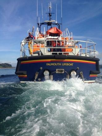 Lifeboats from Falmouth rescue people and dogs on grounded yacht