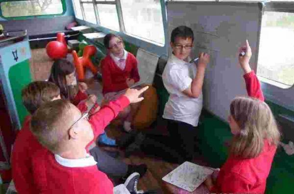 Falmouth Packet: Year six pupils at Parc Eglos enjoy lessons in the bus