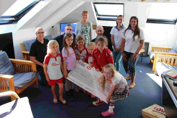 The Rainbows presenting the RNLI team with the proceeds of some of their fundraising efforts