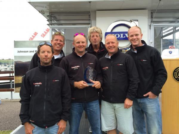 The winning crew with their trophy