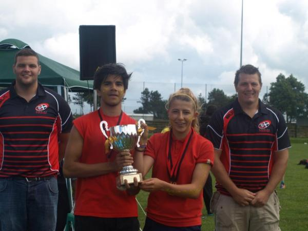 Pendennis House captains Matt Pereira and Izzy Berks receive the winners trophy from Cornish Pirates players Jack Andrews and Rob Elloway