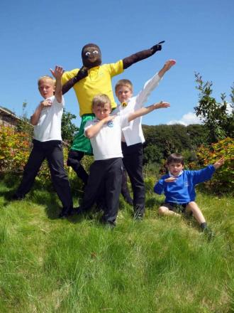 Schoolkids immortalise heroes as scarecrows at Penzance garden