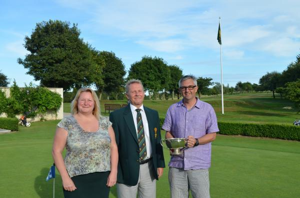 Steve Thomas collects the trophy at Falmouth Golf Club from club captain Lucien Trathen and Falmouth Hotel manager Wendy Parry