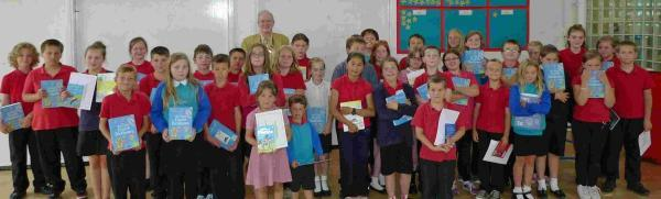 Pupils at assembly at Falmouth Primary School with Rotary president Paul Wyatt