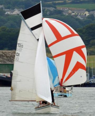 Robin Roebuck's gaffer, Magpie of Mylor, in full sail coming back down the Penryn River to the club finishing line