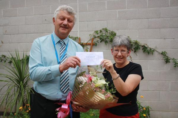 Susan accepted a bouquet of flowers from Malcolm Owen, lead biomedical scientist