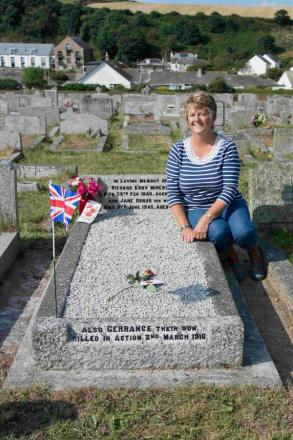 Rita Collier with one of the graves that have been cleaned for the centenary