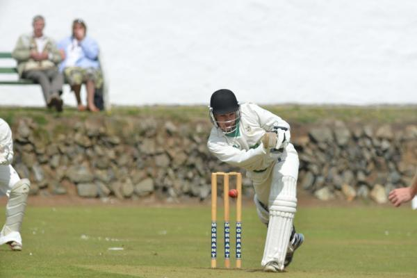 Camborne's Liam Weeks about to be bowled by Falmouth's Glyn Furnival