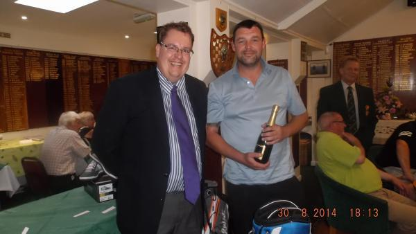 Falmouth Golf Club professional Nick Rogers (left) giving Ray Longstaff his prize