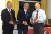 Bob Hartnell (right) is given the bowl from club president Brian Martin (centre) and captain Paul Upperton