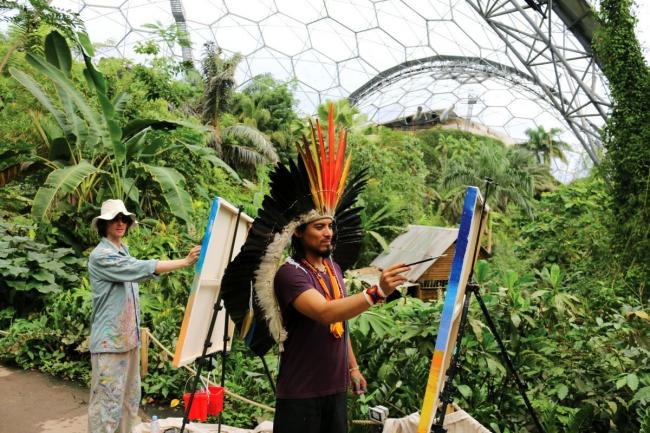 John Dyer (left) and Nixiwaka Yawanawá painting in the Eden Project's Rainforest Biome