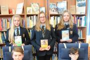 Year seven students in the college library, seated left to right: Kian Gallagher and Barney Martin, stood left to right: Kerensa, Abigail Buckley and Madison Coulthard.