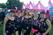 Pink Wiggers Emma Kent, Sue Morant, Naomi Morant, Michelle Bray and Kathryn Stivey at the Moonwalk in London.