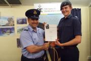 Sgt Sean Cunningham is presented with his Silver Duke of Edinburgh Award by Sqn Ldr Paul Smith.