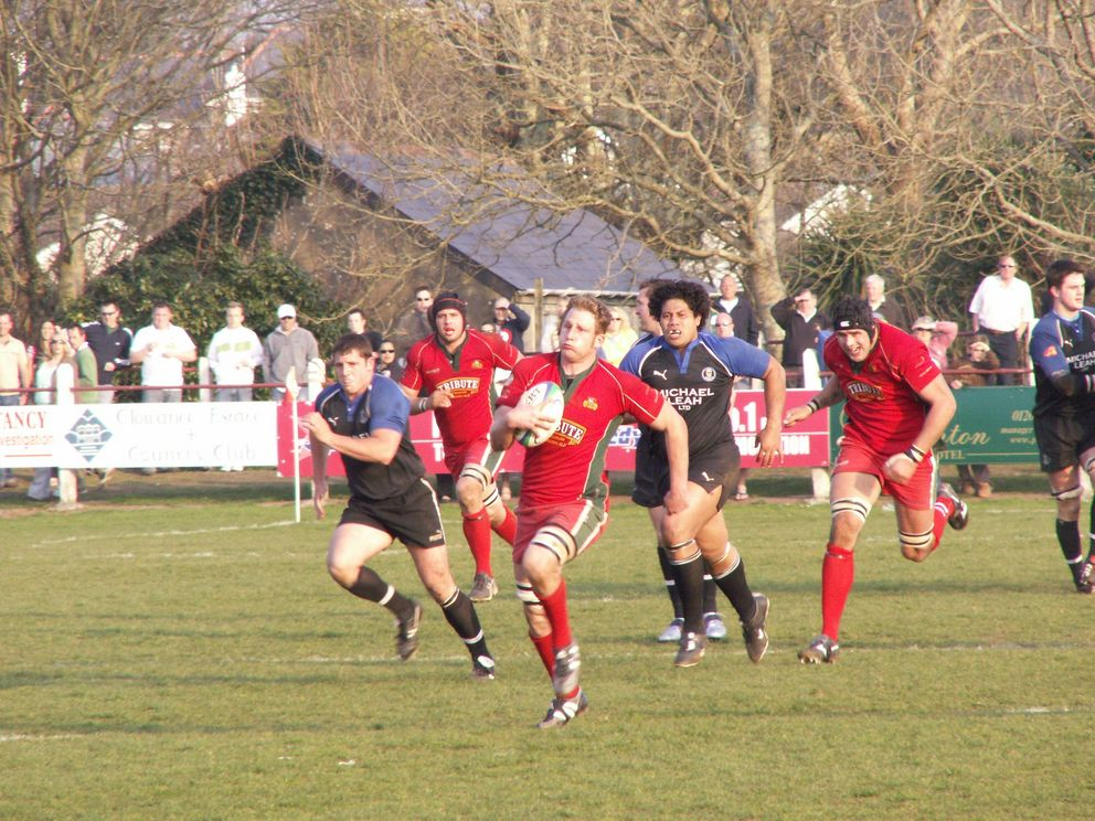 No holding him . . . Redruth's Mark Bright outpaces the Mount's Bay defence to score a try