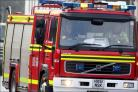 Two rescued in flat fire
