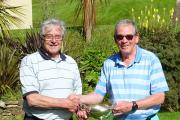 Vice captain Dennis McQuillan presents Brian Martin (left) with the Bill Rowe Memorial Cup