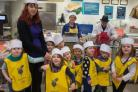 Youngsters from Little Merlins have been visiting Tesco to see where food comes fromo (53861828)