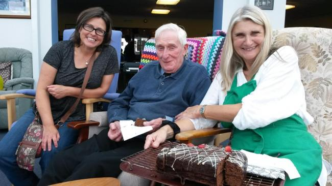 90 year old Robert Hopkins enjoys meeting friendly faces at Hayle Hub free lunch, shown here with Hayle Hub members Jane Haskins (left) and Alison Saunders.