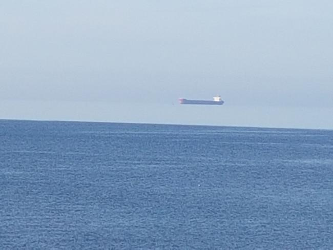 The 'flying' container ship captured by Rosie Patterson off the coast of Porthleven