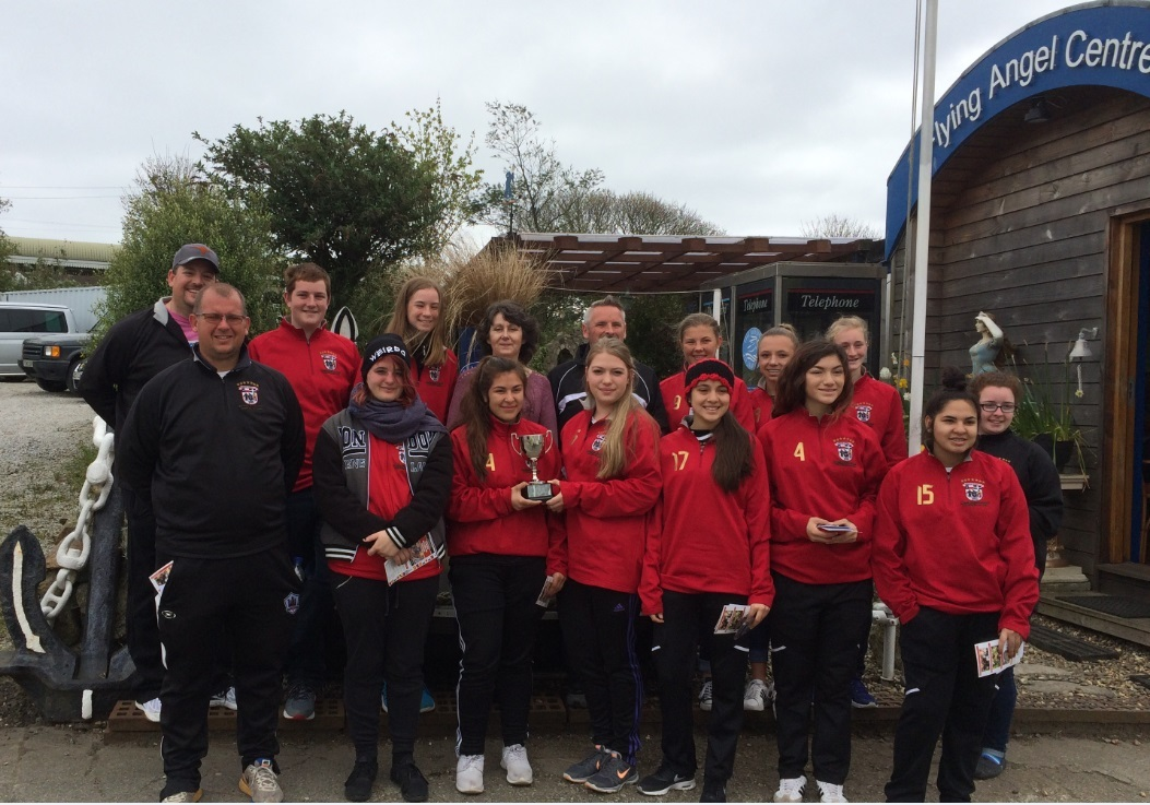 Back fourth from left – Penny Phillips, Fourth from right Antony Penna and the Kernow Storm FC Team and Parents with two team members holding The Mission to Seafarers Challenge Cup 2017