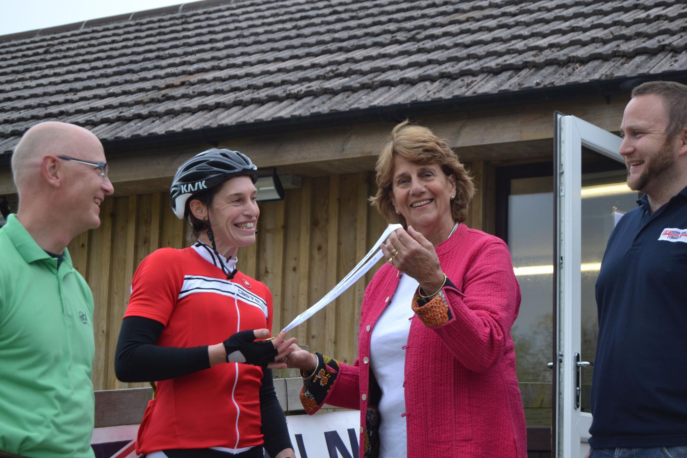 Sarah Coryton, High Sheriff of Cornwall, presents a finishers medal to Keren Spear of Falmouth. Photo: Jess Beckham